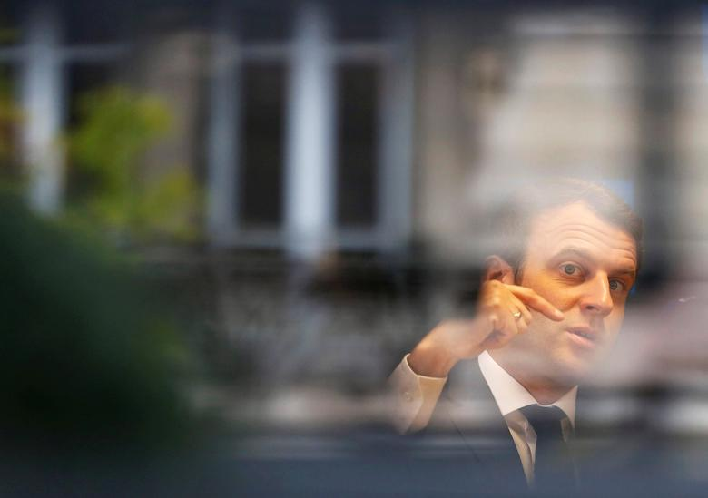 Emmanuel Macron, head of the political movement En Marche !, or Onwards !, and candidate for the 2017 presidential election, is pictured through a window of his hotel during a campaign visit in Rodez, France, May 5, 2017. REUTERS/Regis Duvignau