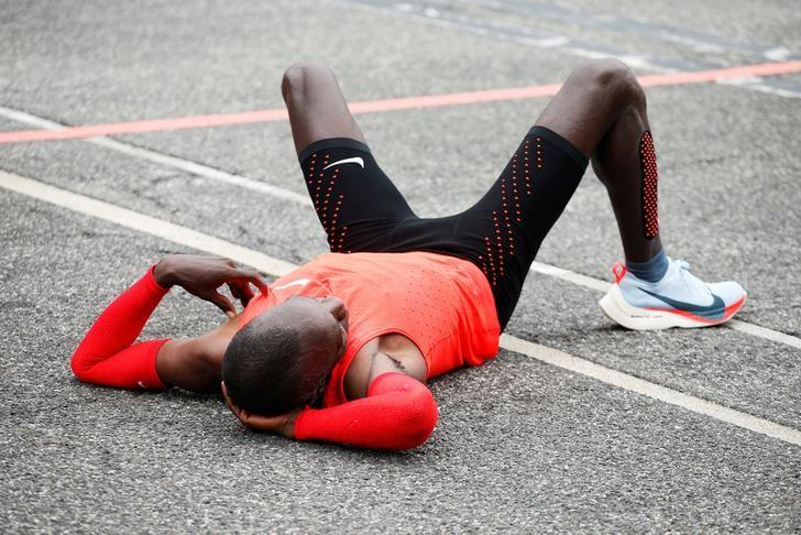 Kenyan Eliud Kipchoge reacts after crossing the finish line during an attempt to break the two-hour marathon barrier at the Monza circuit in Italy, May 6, 2017. REUTERS/Alessandro Garofalo