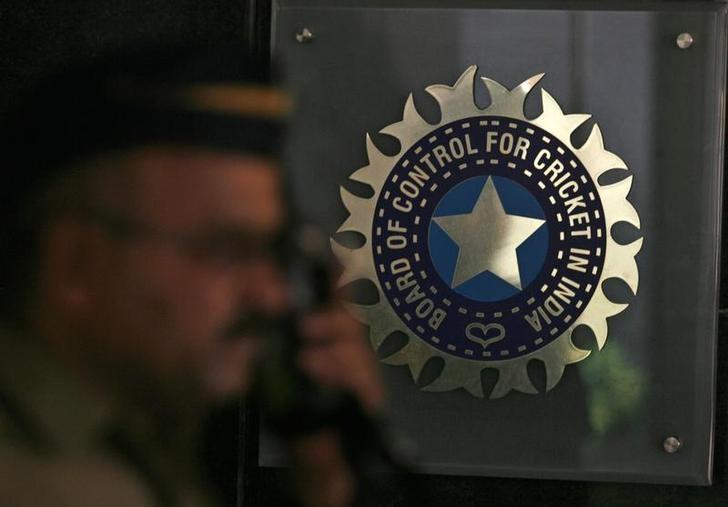 A policeman walks past a logo of the Board of Control for Cricket in India (BCCI) during a governing council meeting of the Indian Premier League (IPL) at BCCI headquarters in Mumbai April 26, 2010. REUTERS/Arko Datta/File Photo