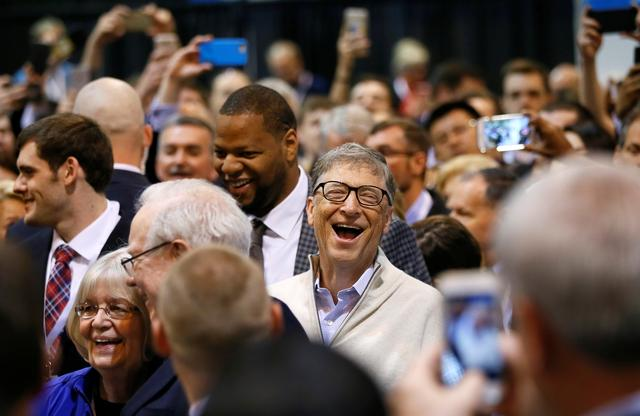 Microsoft co-founder and philanthropist Bill Gates reacts at a newspaper throwing contest before the Berkshire Hathaway annual meeting in Omaha, Nebraska, U.S. May 6, 2017.  REUTERS/Rick Wilking