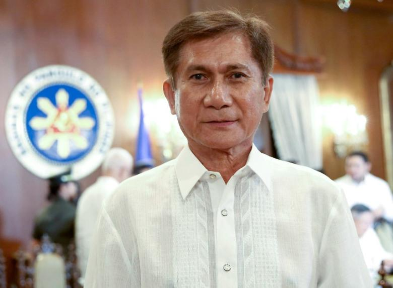 Newly-appointed Environment and Natural Resources Secretary Roy Cimatu poses for a photo before he was sworn into office by President Rodrigo Duterte (not in photo) prior to the start of the Cabinet meeting at the Malacanang presidential palace in Manila, Philippines May 8, 2017. Picture taken May 8, 2017. Malacanang Presidential Palace/Handout via Reuters