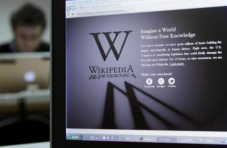 A reporter's laptop shows the Wikipedia blacked out opening page in Brussels in this file photo dated January 18, 2012. REUTERS/Yves Herman