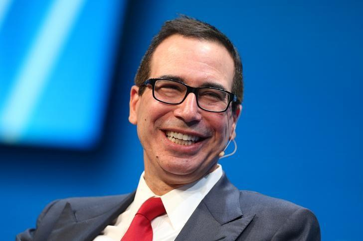 FILE PHOTO: Steven Mnuchin, U.S. Treasury Secretary, laughs during the Milken Institute Global Conference in Beverly Hills, California, U.S., May 1, 2017. REUTERS/Lucy Nicholson