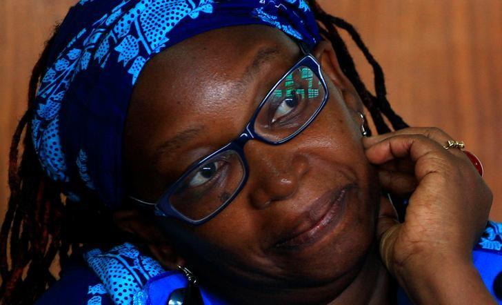 Ugandan prominent academic Stella Nyanzi stands in the dock at Buganda Road court charged with cybercrimes after she posted profanity-filled denunciations of president Yoweri Museveni on Facebook in Kampala, Uganda April 25, 2017. REUTERS/James Akena