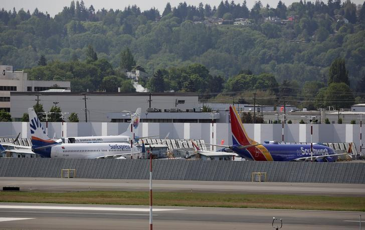 A new Boeing 737MAX (R) sits parked on the tarmac with other 737 models at Boeing Field after coming off the production line in Seattle, Washington, May 9, 2017. REUTERS/Jason Redmond