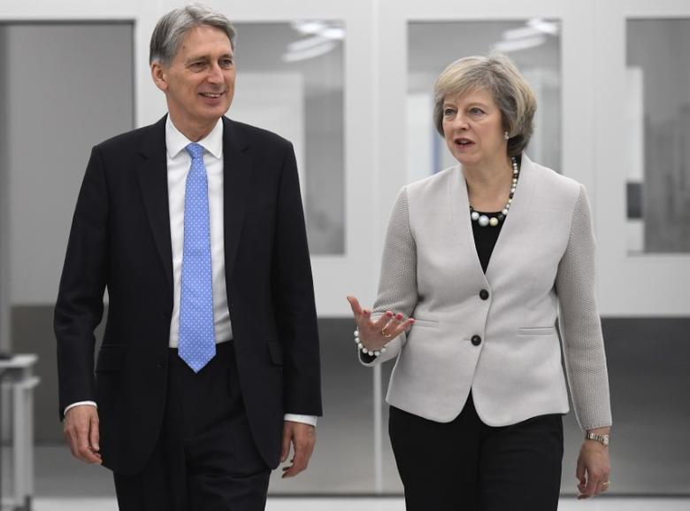 Britain's Prime Minister Theresa May and Chancellor of the Exchequer Philip Hammond tour the Renishaw innovation and engineering plant in Wootton, south west England, in Britain, November 24, 2016. REUTERS/Toby Melville
