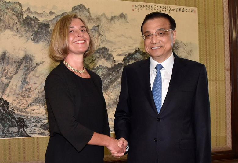 Chinese Premier Li Keqiang shakes hands with the European Union's foreign policy chief, Federica Mogherini before their meeting at the Zhongnanhai leadership compound in Beijing, China, in this file photo dated April 18, 2017. REUTERS/Kenzaburo Fukuhara/Pool