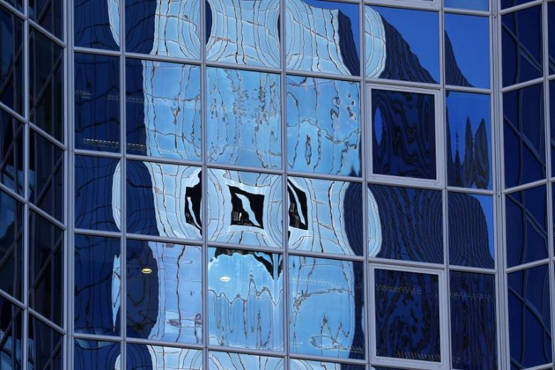 FILE PHOTO: The logo of Germany's Deutsche Bank is reflected in the windows of a skyscraper in Frankfurt, Germany, October 5, 2016.  REUTERS/Kai Pfaffenbach/File Photo
