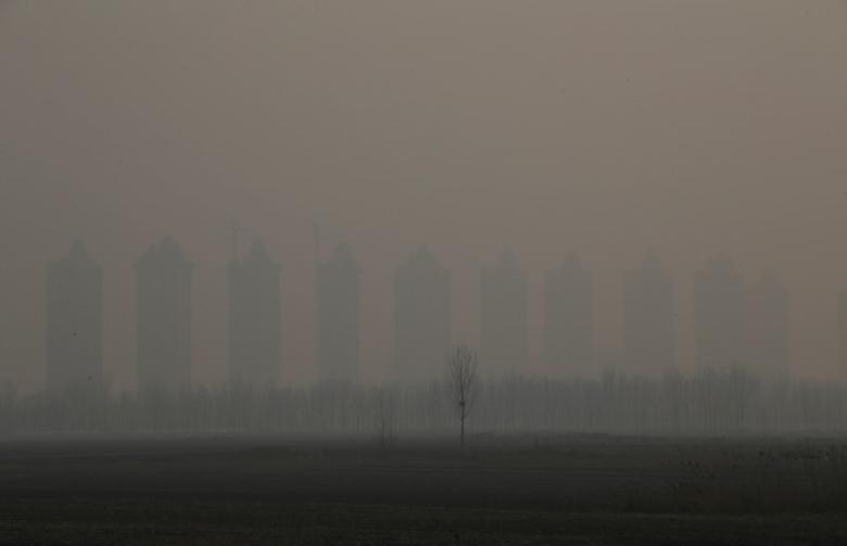 FILE PHOTO: Residential buildings under construction are pictured on a polluted day after the Chinese Lunar New Year holidays on the outskirts of Langfang, Hebei province, China, February 3, 2017. REUTERS/Jason Lee/File Photo