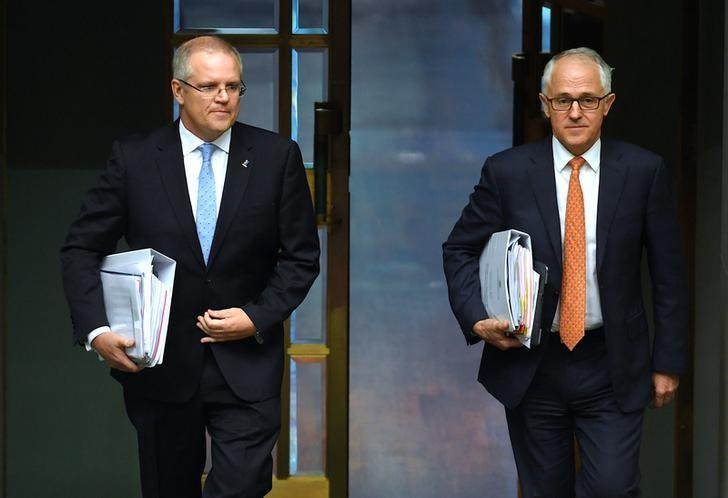 Australian Prime Minister Malcolm Turnbull (R) and Australian Treasurer Scott Morrison walk into the House of Representatives at Parliament House in Canberra, Australia, May 10, 2017.    AAP/Lukas Coch/via REUTERS