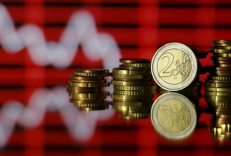 Euro coins are seen in front of a displayed stock graph in this photo illustration taken June 30, 2015. REUTERS/Dado Ruvic/Illustration/File Photo