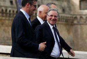 Governor of the Bank of Italy Ignazio Visco (R) smiles as he leaves the G7 for Financial ministers meeting in the southern Italian city of Bari, Italy, May 12, 2017. REUTERS/Alessandro Bianchi