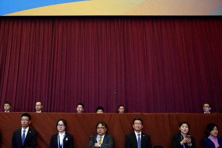 People listen to Chinese President Xi Jinping speak during the opening ceremony of the Belt and Road Forum in Beijing, China, May 14, 2017.  REUTERS/Thomas Peter
