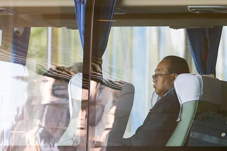 Kim Yong Jae, North Korea's minister of external economic relations, sits in a bus leaving the Belt and Road Forum in Beijing, China, May 14, 2017. Picture taken through a window. REUTERS/Thomas Peter