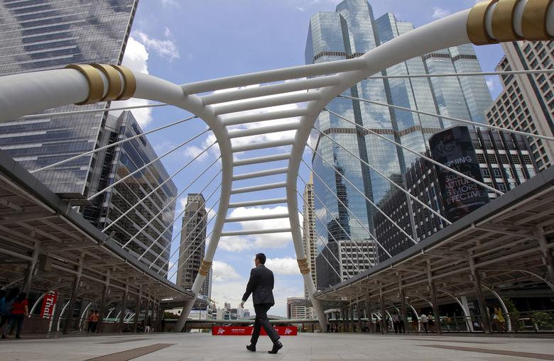 FILE PHOTO: A man walks in business area in Bangkok, Thailand, May 22, 2015.  REUTERS/Chaiwat Subprasom/File Photo