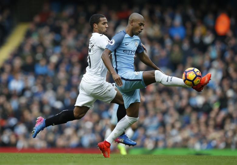 Britain Soccer Football - Manchester City v Swansea City - Premier League - Etihad Stadium - 5/2/17 Manchester City's Fernandinho in action with Swansea City's Wayne Routledge  Reuters / Andrew Yates Livepic