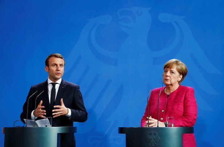German Chancellor Angela Merkel and French President Emmanuel Macron address a news conference at the Chancellery in Berlin, Germany, May 15, 2017.   REUTERS/Fabrizio Bensch