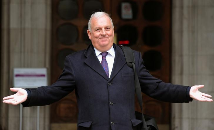 Former Sun newspaper editor Kelvin MacKenzie gestures as he leaves the Leveson Inquiry at the High Court in central London, January 9, 2012. REUTERS/Paul Hackett/Files