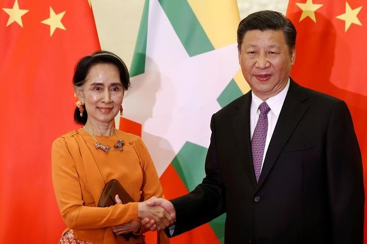 Myanmar State Counsellor Aung San Suu Kyi shakes hands with Chinese President Xi Jinping as they meet at the Great Hall of the People in Beijing, China, May 16, 2017.   REUTERS/Damir Sagolj