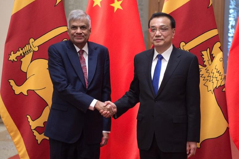 Sri Lankan Prime Minister Ranil Wickremesinghe (L) shakes hands with Chinese Premier Li Keqiang (R) at the Great Hall of the People in Beijing, China May 16, 2017. REUTERS/Nicolas Asfouri/Pool