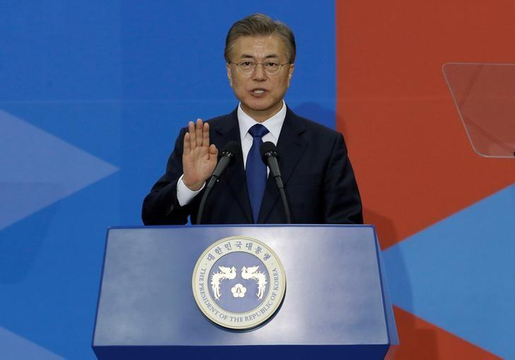 FILE PHOTO: Newly elected South Korean President Moon Jae-in takes an oath during his inauguration ceremony at the National Assembly in Seoul, South Korea, May 10, 2017. REUTERS/Ahn Young-joon/Pool/File Photo