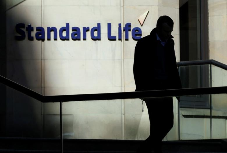 FILE PHOTO: A worker leaves the Standard Life House in Edinburgh, Scotland, Britain, February 27, 2014.    REUTERS/Russell Cheyne/File Photo