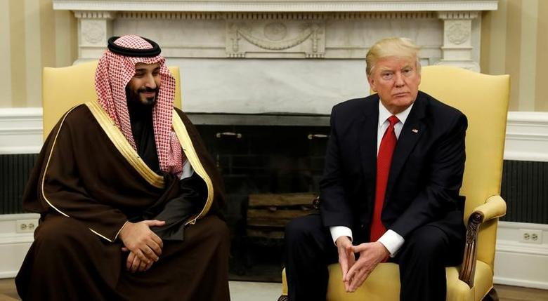 FILE PHOTO: U.S. President Donald Trump meets with Saudi Deputy Crown Prince and Minister of Defense Mohammed bin Salman in the Oval Office of the White House in Washington, U.S., March 14, 2017. REUTERS/Kevin Lamarque