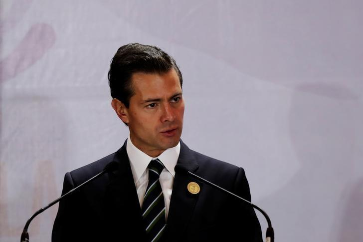 President Enrique Pena Nieto, addresses the audience during the XVI Summit of Heads of State and Government of the Tuxtla Mechanism for Dialogue and Coordination in San Jose, Costa Rica March 29, 2017. REUTERS/Randall Campos/Files