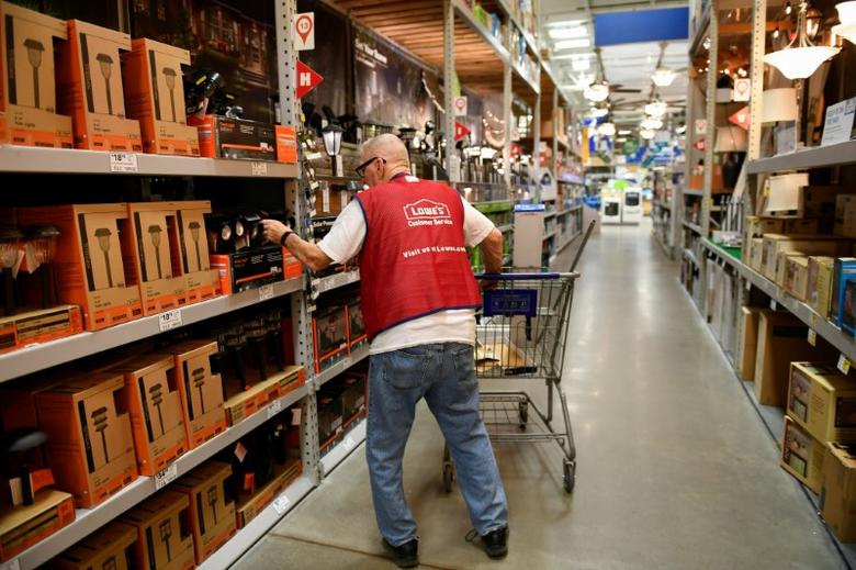 FILE PHOTO: An employee restocks items at a Lowe's home improvement chain in Austin, Texas, U.S., February 27, 2017. REUTERS/Mohammad Khursheed