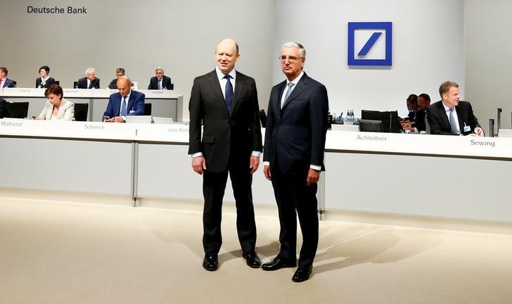 Deutsche Bank CEO John Cryan and supervisory board chairman Paul Achleitner attend the bank's annual general meeting in Frankfurt, Germany May 18, 2017.  REUTERS/Ralph Orlowski