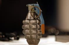 A hand grenade is displayed at a news conference at City Hall in New York,  file.   REUTERS/Mike Segar
