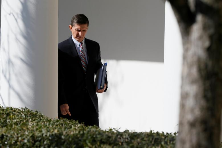 White House National Security Advisor Michael Flynn walks down the White House colonnade on the way to Japanese Prime Minister Shinzo Abe and President Trump's joint news conference at the White House. REUTERS/Jim Bourg