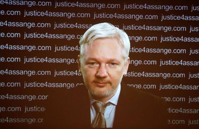 FILE PHOTO: WikiLeaks founder Julian Assange appears on screen via video link during a news conference at the Frontline Club in London, Britain February 5, 2016. REUTERS/Neil Hall/File Photo