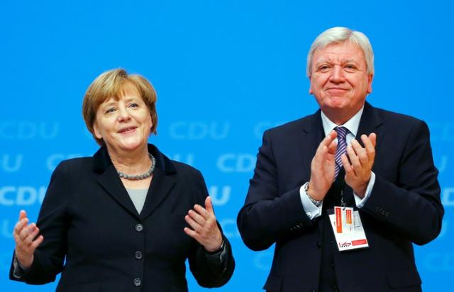 FILE PHOTO: German Chancellor Angela Merkel and Hesse's state Premier Volker Bouffier during the party congress in Karlsruhe, Germany December 14, 2015.   REUTERS/Kai Pfaffenbach/File Photo