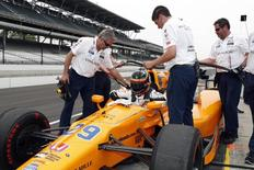 Verizon IndyCar Series driver Fernando Alonso gets in his car during practice for the 101st Running of the Indianapolis 500 at Indianapolis Motor Speedway. Mandatory Credit: Brian Spurlock