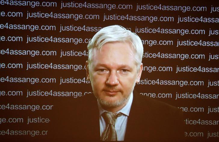 WikiLeaks founder Julian Assange appears on screen via video link during a news conference at the Frontline Club in London, Britain February 5, 2016. REUTERS/Neil Hall/Files