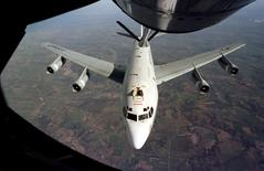 A U.S. Air Force WC-135 Constant Phoenix aircraft is refuelled from an air tanker in an undated photo. U.S. Air Force/Handout via REUTERS