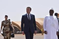 French President Emmanuel Macron walks with Mali's President Ibrahim Boubacar Keita (R) as he visits French troops in Africa's Sahel region in Gao, northern Mali, 19 May 2017.         REUTERS/Christophe Petit Tesson/pool