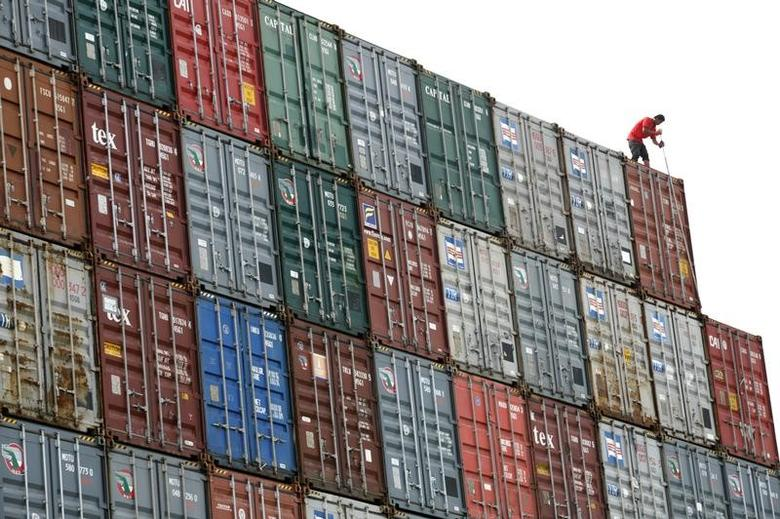 A worker inspects a container at North Port in Port Klang outside Kuala Lumpur.  REUTERS/Bazuki Muhammad