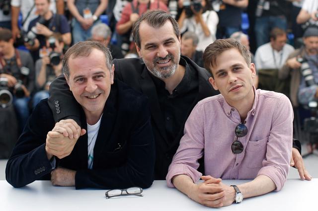 70th Cannes Film Festival - Photocall for the film ''Jupiter's Moon'' (Jupiter holdja) in competition - Cannes, France. 19/05/2017. Director Kornel Mundruczo and cast member Merad Ninidze and Zsombor Jeger pose. REUTERS/Stephane Mahe