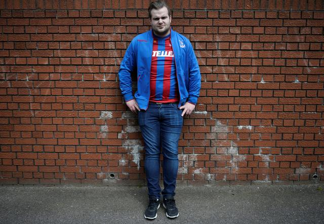 Crystal Palace soccer fan Emil Ellertz, 27, from Sundsvall in Sweden, poses for a photograph at a Premier League soccer match between Crystal Palace and Leicester City in London, Britain April 15, 2017. REUTERS/Hannah McKay