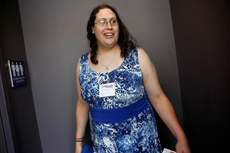 Kate Lynn Blatt, a transgender woman, laughs outside a gender-neutral bathroom at the 15th Annual Philadelphia Trans-Health Conference in Philadelphia, Pennsylvania, United States, June 9, 2016.  REUTERS/Shannon Stapleton