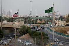 A Saudi Arabia's and United States' flags are seen on Meccah Road as security check point are set up ahead of the visit of the United States President Donald Trump, in Riyadh, Saudi Arabia, May 19, 2017. REUTERS/Hamad I Mohammed