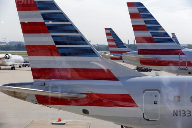 FILE PHOTO: American Airlines aircraft are parked at Ronald Reagan Washington National Airport in Washington, U.S., August 8, 2016.      REUTERS/Joshua Roberts/File Photo