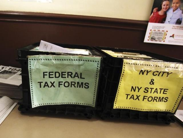 FILE PHOTO - Crates filled with 2011 tax forms are seen at the 96th Street Public Library in New York April 17, 2012. REUTERS/Shannon Stapleton