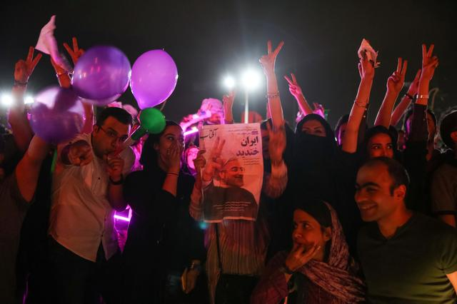 Supporters of Iran's President Hassan Rouhani celebrate his victory in the presidential elections, in the streets of Tehran, Iran, May 20, 2017.    TIMA via REUTERS