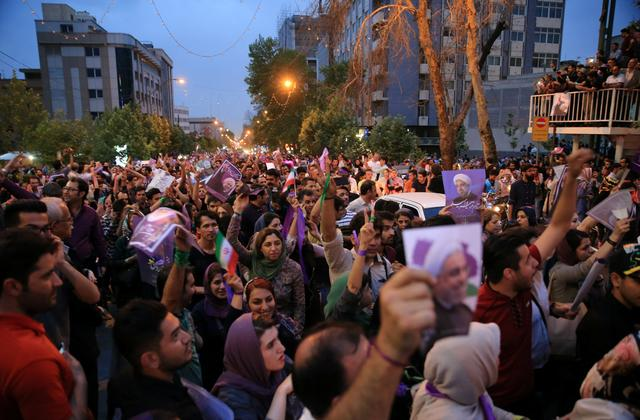 Supporters of Iranian president Hassan Rouhani gather as they celebrate his victory in the presidential election in Tehran, Iran, May 20, 2017. TIMA via REUTERS