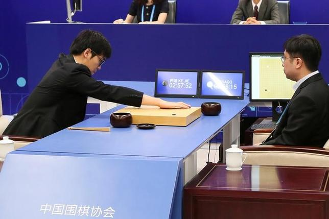 Chinese Go player Ke Jie puts a stone against Google's artificial intelligence program AlphaGo during their first match at the Future of Go Summit in Wuzhen, Zhejiang province, China May 23, 2017. REUTERS/Stringer ATTENTION EDITORS - THIS IMAGE WAS PROVIDED BY A THIRD PARTY. EDITORIAL USE ONLY. CHINA OUT. NO COMMERCIAL OR EDITORIAL SALES IN CHINA.       TPX IMAGES OF THE DAY - RTX37431