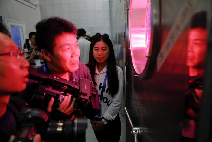 Reporters peek inside a simulated space cabin in which volunteers temporarily live as a part of the scientistic Lunar Palace 365 Project, at Beihang University in Beijing, China July 9, 2017. Damir Sagolj