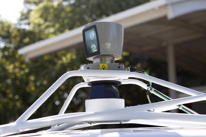 A sensor is seen spinning atop a Google self-driving vehicle before a presentation at the Computer History Museum in Mountain View, California, U.S., May 13, 2014. Stephen Lam